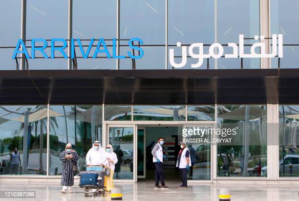Kuwaiti nationals, residing abroad, leave the Kuwait International airport in the capital upon their return as part of a repatriation plan on April...