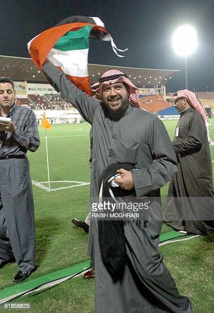 Kuwaiti Oil Minister Ahmed Fahd alSabah waves a national flag at the end of the 17th Arabian Gulf Cup match between Kuwait and Bahrain in Doha 14...
