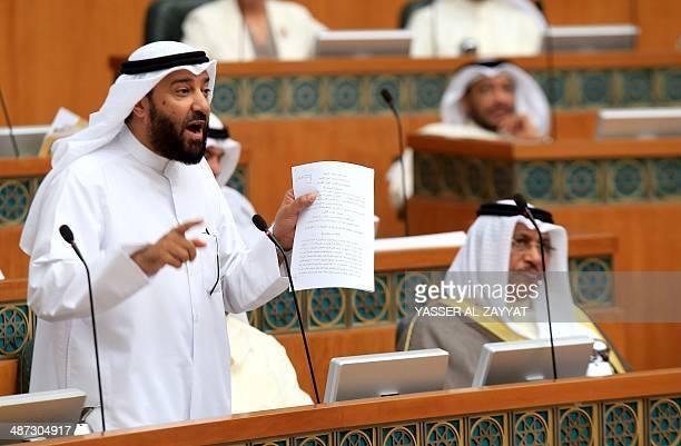 Kuwaiti Oil Minister Ali alOmairi speaks during a parliamentary grilling session against Kuwaiti Prime Minister Sheikh Jaber alMubarak alSabah on...