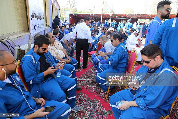 Kuwaiti oil workers arrive at the union headquarter in AlAhmadi 35 km south of Kuwait city on April 17 to protest alleged pay cuts and plans to...