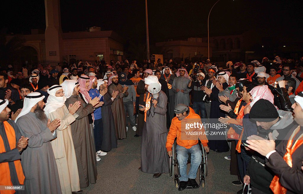 Kuwaiti opposition protestors chants slogans demanding that the new parliament be dissolved and controversial legislation be scrapped during a demonstration in Kuwait City on January 6, 2013. Kuwaiti riot police fired tear gas and stun grenades at hundreds of the demonstrators and arrested several including Osama al-Shaheen, a member of the previous opposition-dominated parliament.