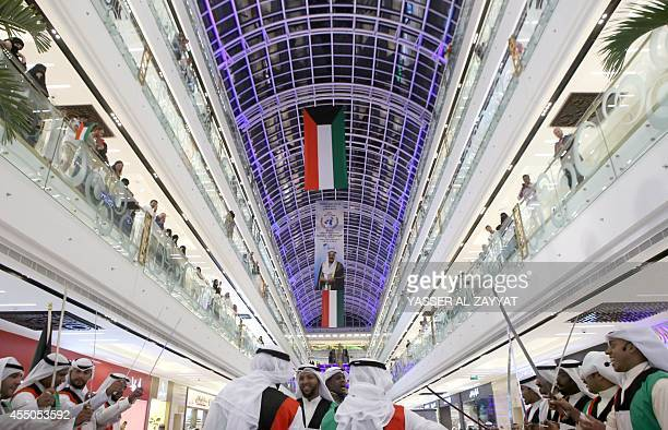 Kuwaiti perform a traditional dance as part of celebrations in Kuwait city on September 9 for the announcement that the Emir of Kuwait Sheikh Sabah...