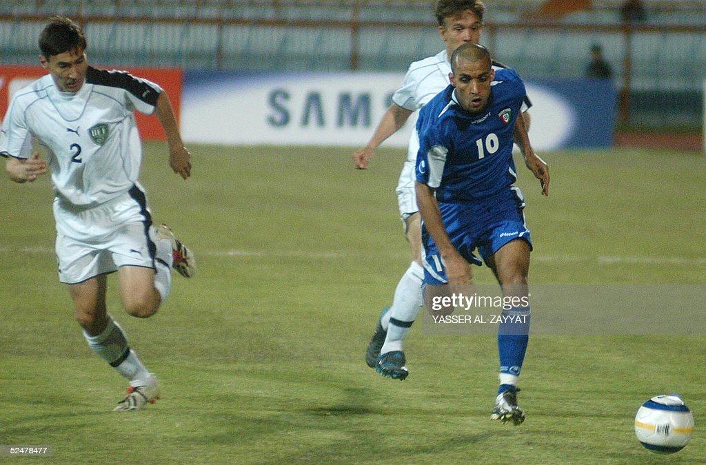 Kuwaiti player Fahd al-Hamad (R) vies wi : News Photo