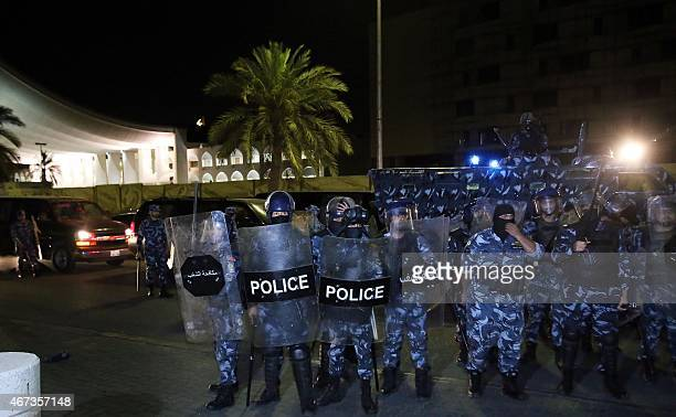 Kuwaiti policemen stand guard during a demonstration of opposition protesters to demand the release of political prisoners and press for democratic...