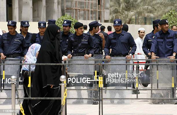Kuwaiti policemen stand guard outside the Grand Mosque in Kuwait City on April 29 2011 after dispersing a protest by Kuwaitis against the Syrian...