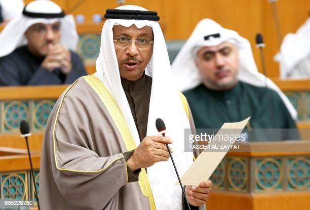 Kuwaiti Prime Minister Sheikh Jaber alMubarak alSabah takes an oath during a parliament session at Kuwait's National Assembly in Kuwait City on...