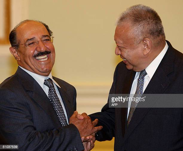Kuwaiti Prime Minister Sheikh Sabah alAhmad alSabah shares a light moment with Hong Kong Chief Executive Tung Cheehwa during their meeting at the...