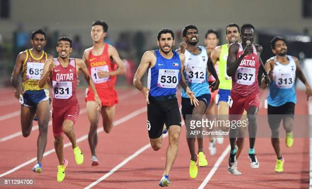 Kuwaiti runner R Alzofairi competes in the men's 800m to win gold on the final day of the 22nd Asian Athletics Championships at Kalinga Stadium in...
