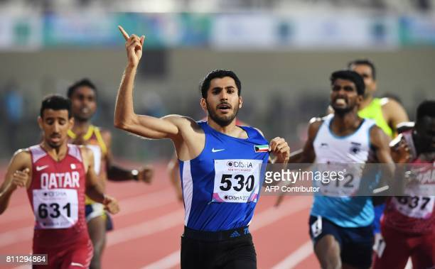 Kuwaiti runner R Alzofairi reacts after competing in the men's 800m to win gold on the final day of the 22nd Asian Athletics Championships at Kalinga...