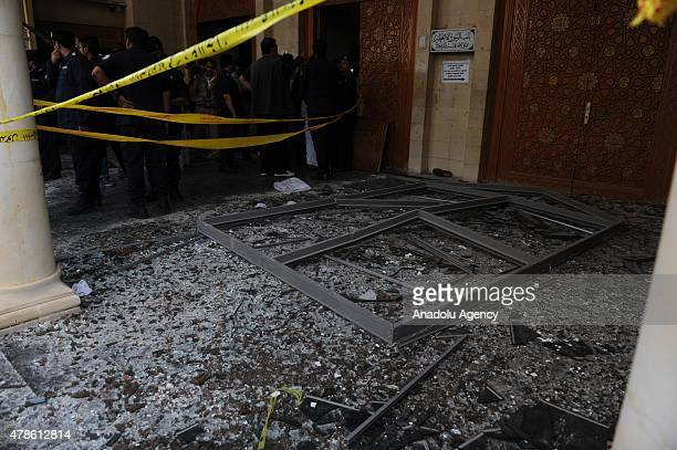 Kuwaiti security officials inspect the site of a suicide bomb attack targeting the Imam Sadiq Mosque in the Sawaber area of Kuwait City on June 26...