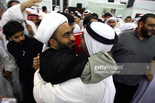 A Kuwaiti Shiite man embraces prominent cleric Sheikh Hussein alMaatuq at a mosque in Kuwait City on March 11 2008 after his release from detention...