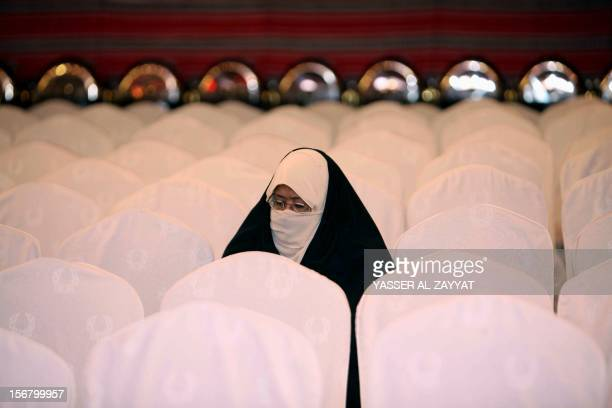 A Kuwaiti Shiite Muslim supporter of candidate in the Gulf emirate's upcoming parliamentary elections Mona alGhareeb sits at an electoral rally...