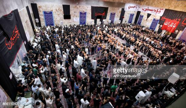 Kuwaiti Shiite Muslims take part in a traditional mourning event during Ashura commemorations that mark the killing of Imam Hussein one of Shiite...