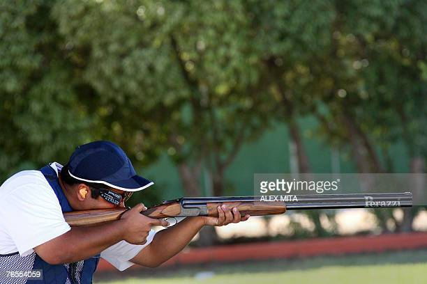 Kuwaiti shooter Khaled alMudhaf prepares to fire during the men's trap final of the ISSF World Shooting Championships held in Nicosia Cyprus 06...