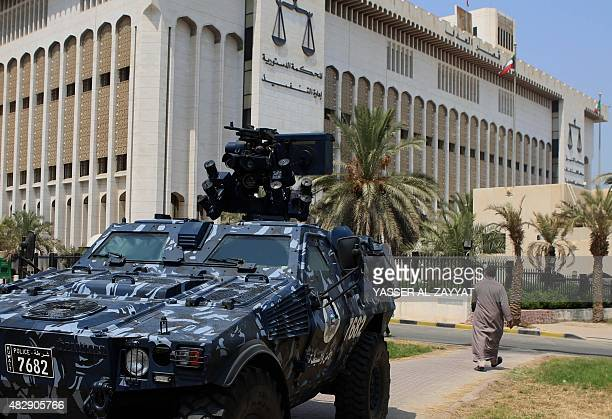 A Kuwaiti special forces vehicle is parked outside the constitutional court in Kuwait City on August 4 2015 The trial of 29 suspects charged over a...