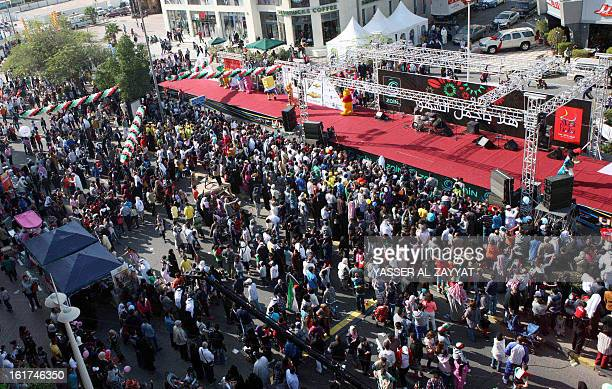 Kuwaiti take part in the launching ceremony of the Hala shopping festival in Kuwait City on February 15 2013 The annual festival which takes place...