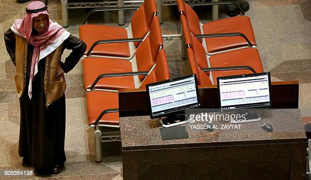 A Kuwaiti trader follows the stock market activity at the Kuwait Stock Exchange in Kuwait City on January 17 2015 Share prices in the energyrich Gulf...