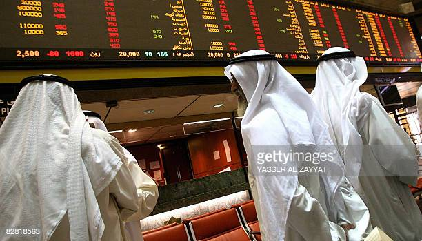 Kuwaiti traders follow the market's movement at the Stock Exchange in Kuwait City on September 15 2008 Stock markets across the energyrich Gulf fell...