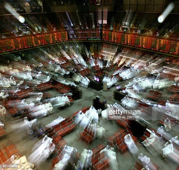 Kuwaiti traders follow the market's movement at the Stock Exchange in Kuwait City on October 6 2008 Kuwait Stock Exchange the second largest in the...
