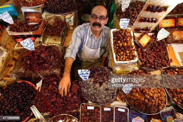A Kuwaiti vendor arranges dates at a market on June 18 on the first day of the holy Muslim fasting month of Ramadan in downtown Kuwait City For...
