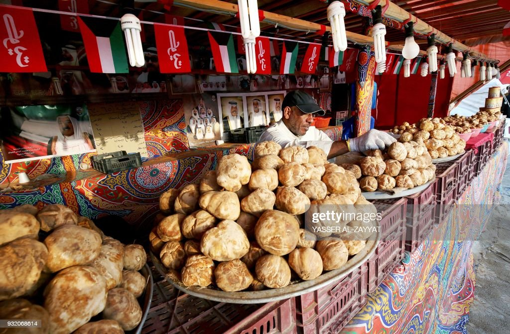 A Kuwaiti vendor arranges truffles for sale at a market in