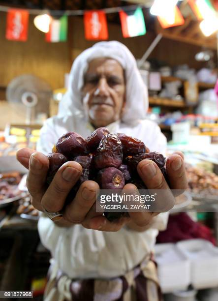 A Kuwaiti vendor displays dates at a market in downtown Kuwait City on June 3 during the holy Muslim month of Ramadan Ramadan is sacred to Muslims...