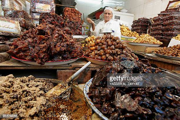 A Kuwaiti vendor sells dates at a market during the second day of the Muslim holy month of Ramadan in Kuwait City on September 2 2008 Muslim...