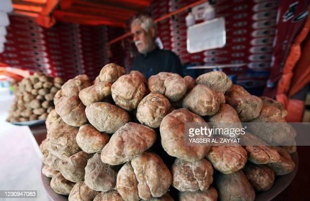 Kuwaiti vendor sells desert truffles at a market in the capital Kuwait City of February 3, 2021. - The desert truffle, an underground fungus is...