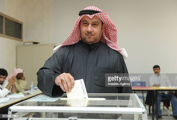 Kuwaiti voter casts his ballot during the general election at the Sayyed Hassan AlMusawi school on November 26 in Kuwaiti City Kuwait