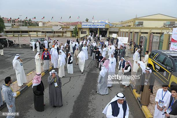 Kuwaiti voters arrive to cast their ballots during the general election at the Sayyed Hassan AlMusawi school on November 26 in Kuwaiti City Kuwait