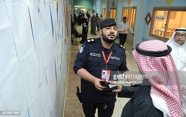 Kuwaiti voters cast their ballots during the general election at the Sayyed Hassan AlMusawi school on November 26 in Kuwaiti City Kuwait
