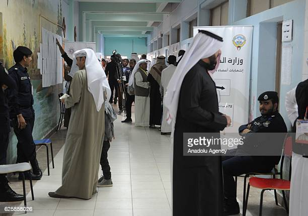 Kuwaiti voters wait to cast their ballots during the general election at the Sayyed Hassan AlMusawi school on November 26 in Kuwaiti City Kuwait