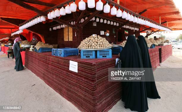 Kuwaiti women buy desert truffles at a market in the capital Kuwait City of February 3, 2021. - The desert truffle, an underground fungus is unique...