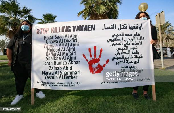Kuwaiti women carry a banner during a rally to denounce violence against women, outside the National Assembly, in the capital Kuwait City, on April...