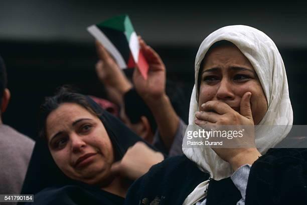 Kuwaiti women crying after the Liberation