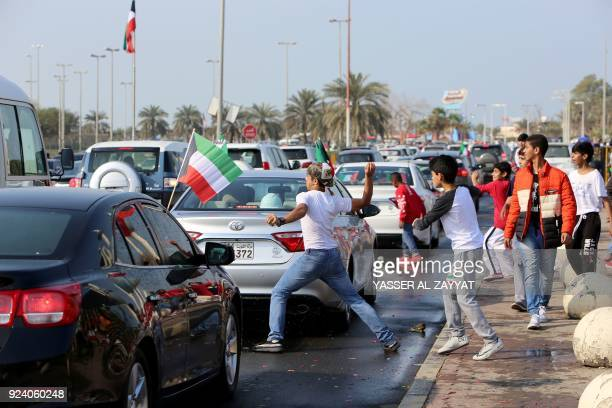 Kuwaiti youth throw water balloons as they celebrate the country's 57th Independence Day and the 27th anniversary of the end of the Gulf war with the...