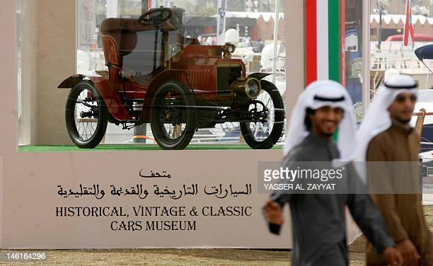 Kuwaiti youths visit the Historical Vintage and Classic Cars exhibition at Marina Crescent in Salmeyya district of Kuwait City on February 17 2012...