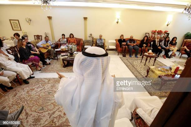 Kuwaitis and expatriates adhering to the Baha'i faith gather to worship and peform religious rituals before beginning the fasting season in Kuwait...