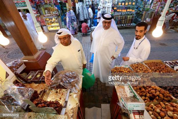 Kuwaitis buy dates at a market in Kuwait City on May 17 on the first day of the Islamic holy month of Ramadan Islam's holy month of Ramadan is...