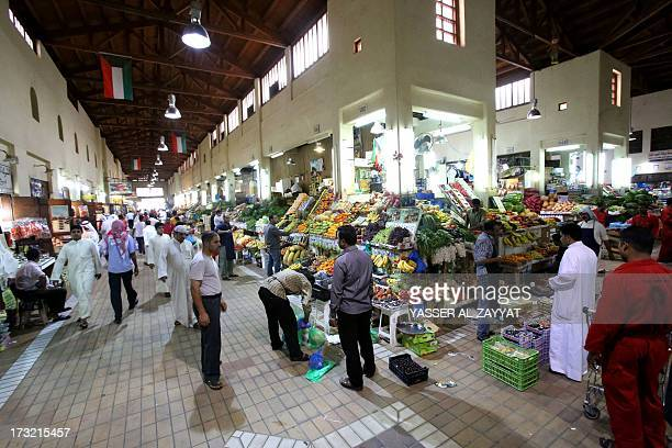 Kuwaitis buy fruits and vegetables at a market place on July 10 2013 in downtown Kuwait City on the first day of the Muslim fasting month of Ramadan...