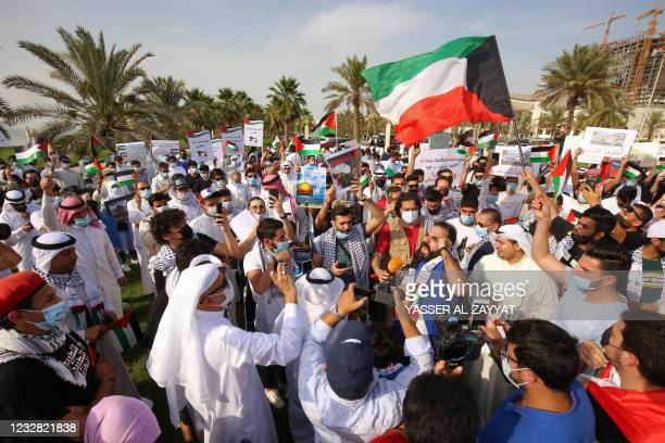 Kuwaitis chant slogans during a protest in solidarity with the Palestinian people in Kuwait City on May 11, 2021.