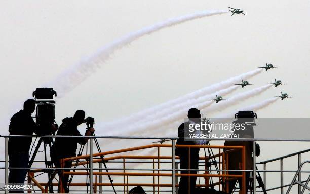 Kuwaitis film as Saudi falcon Hawk Mk 65 A aircrafts perform during the Kuwait aviation show in Kuwait City on January 17 2018 / AFP PHOTO / YASSER...
