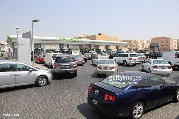 Kuwaitis queue up to fill their cars with fuel at a petrol station in Kuwait City on August 31 2016 on the eve of increased petrol prices The Kuwaiti...