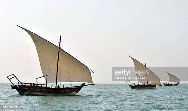 Kuwaitis sail in traditional dhows off Kuwait City as they compete in the 'Battle of Riqqa' during preparations for the upcoming annual pearl diving...