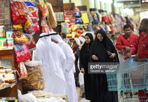 Kuwaitis shop at a market during the holy month of Ramadan in downtown Kuwait City on June 12 2017 For Muslims across the world the beginning of the...