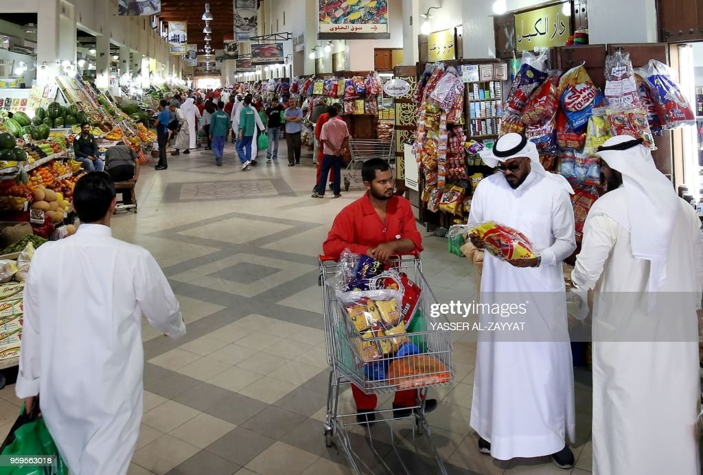 Kuwaitis shop at a market in Kuwait City on May 17 on the first day