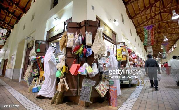 Kuwaitis shop at a market on the first day of the holy month of Ramadan in downtown Kuwait City on May 27 2017 For Muslims across the world the...