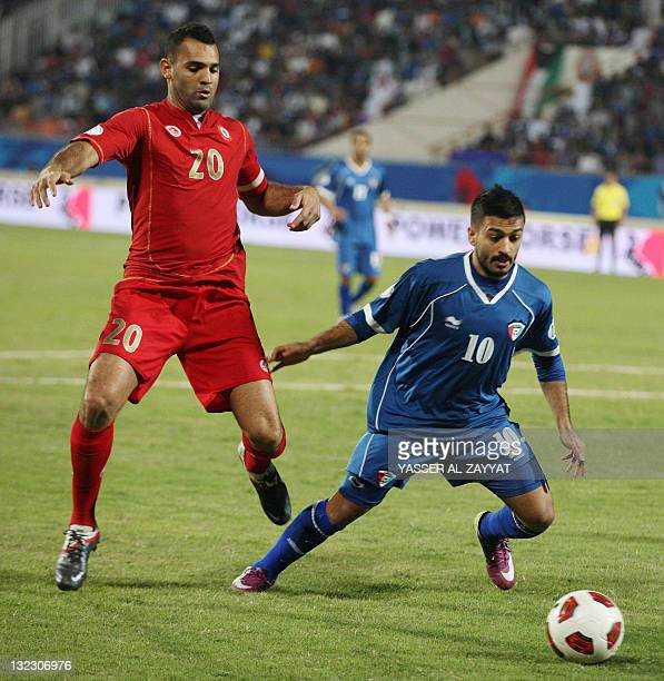 Kuwait's Abdul Aziz alMeshaan challenges Lebanon's Rida Antar during their 2014 World Cup Asian zone qualifying football match in Kuwait City on...