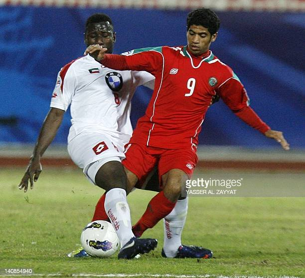 Kuwait's alKuwait club player Lassana Fane vies for the ball against Saudi's alIttefaq club player Hamad alHamad during their AFC Cup football match...