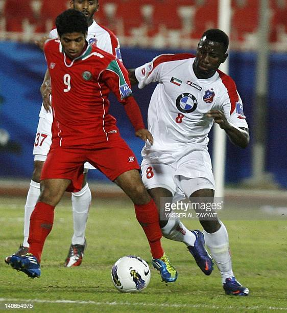 Kuwait's alKuwait club player Lassana Fane vies for the ball against Saudi's alIttifaq club player Hamad alHamad during their AFC Cup football match...